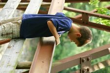 Free Boy Looking Over Bridge Royalty Free Stock Images - 1242909