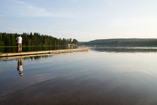 Free Man Watching A Still Lake Royalty Free Stock Images - 1243789