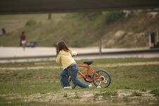 Free Girl Push A Bicycle Stock Photography - 1245352