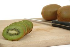 Free Kiwi Slices With Knife Stock Images - 1248734