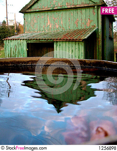 Free Old Shed Reflected Royalty Free Stock Photos - 1256898