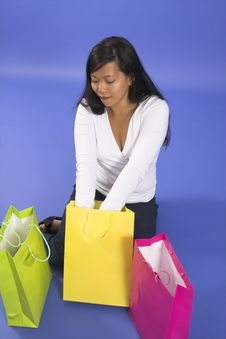 Free Woman Sitting With Shopping Bags Stock Photo - 1252260