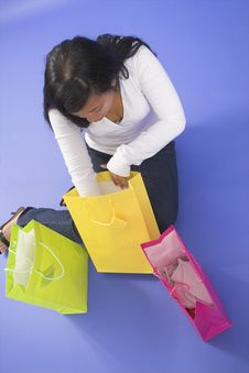 Woman Sitting With Shopping Bags Royalty Free Stock Images