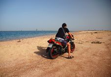 Free Biker On The Beach Royalty Free Stock Photo - 1252935