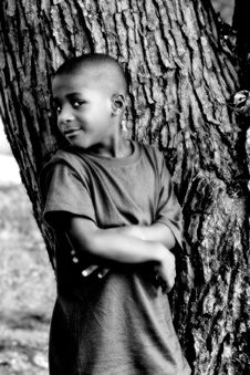 Free Boy Against A Tree Stock Photography - 1255072