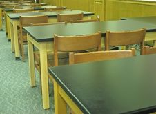 Free Old-fashioned Desks And Chairs. Royalty Free Stock Images - 1257449