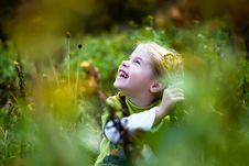 Free Little Girl Through The Grass Royalty Free Stock Image - 12526356
