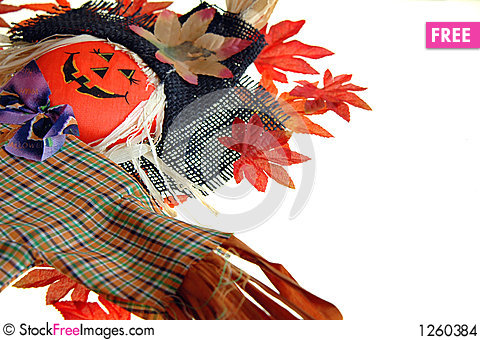 Scarecrow and colorful leaves Stock Photo