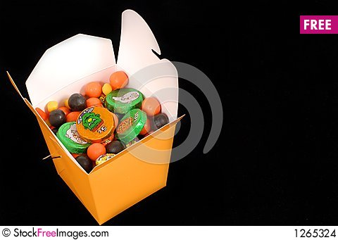 Free Halloween Candy In An Orange Chinese Food Container Stock Images - 1265324