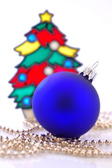 A Glass Ball And A Christmas Tree Royalty Free Stock Photos