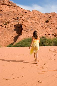 Girl Walking On Sand Dunes Stock Photography