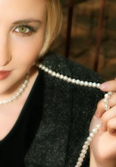 Young Blond Woman In Gray Wool Jacket And Pearls