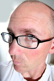 Free Blue Eyed Bald Man Looks Closer Royalty Free Stock Photos - 1265128