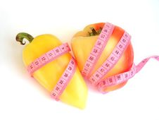 Free Two Peppers With Pink Tape Measure Against White Background Royalty Free Stock Photos - 1268238