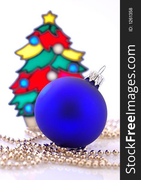 A glass ball and a christmas tree