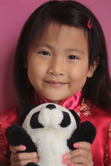 Free Asian Girl In Red Silk Dress With Panda Stock Photos - 12608863