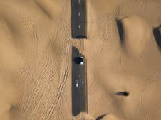 Free Bird S Eye Photography Of Road In Middle Of Dessert Stock Photography - 126175842