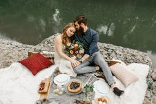 Free Couple Sitting Beside Calm Body Of Water Royalty Free Stock Photography - 126175967