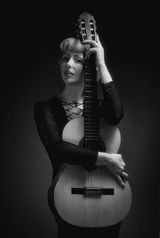 Free Woman In Black Long-sleeved Dress Holding Classical Guitar Royalty Free Stock Photography - 126176037