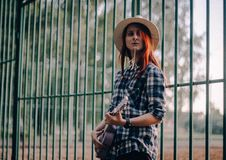Free Woman Standing Near Green Fence While Playing Guitar Stock Image - 126176291
