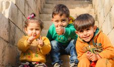 Free Three Children Sitting On Stairs Stock Images - 126176404