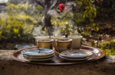 Free White Floral Tea Cups And Saucers On Brown Wooden Tray Royalty Free Stock Image - 126176456