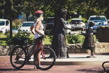 Free Woman Wearing White Tank Top Holding Red Hardtail Mountain Bike Stock Photo - 126176560