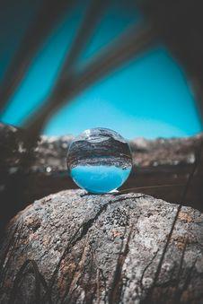 Free Crystal Ball On Rock Stock Image - 126177011