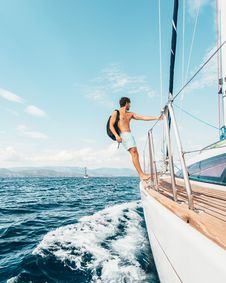 Free Man Standing On The Edge Of Boat Royalty Free Stock Photo - 126177035