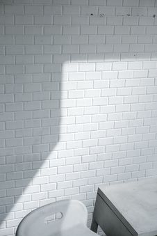 Free White Brick Wall Near White Chair Stock Image - 126177291