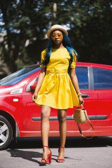 Free Woman Wearing Yellow Boat-neck Short-sleeved Dress Standing Near Red Car Stock Photography - 126177302