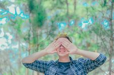 Free Man Covered Eyes By His Hand Standing On Surrounded Trees Stock Photos - 126177323