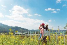 Free Two Women Standing Surrounded Yellow Petaled Flower Field Under Blue Sky Stock Image - 126177451