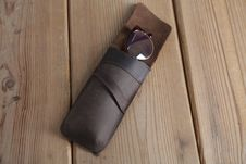 Free Eyeglasses In Brown Leather Case On Top Of Wooden Surface Royalty Free Stock Photography - 126177517
