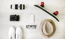 Free Photography Of Black Skateboard, White Iphone 5, Brown Hat, Black Point-and-shoot Camera, And Zoom Lens Royalty Free Stock Images - 126177529