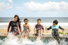 Free Woman And Three Children Playing Water Royalty Free Stock Photography - 126177617