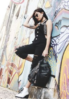 Free Woman Holding Backpack While Leaning On Wall Royalty Free Stock Photos - 126177678