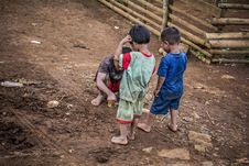 Free Three Children Standing On Brown Soil Royalty Free Stock Photo - 126177705