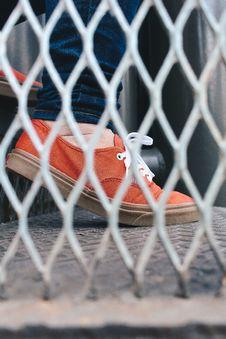 Free Person Wearing Orange Low-top Sneaker Stock Image - 126177841