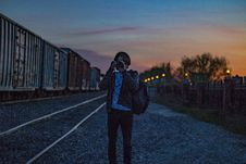 Free Man Wearing Brown Jacket With Backpack Taking Photo During Golden Hour Stock Photos - 126177953