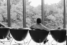 Free Grayscale Photo Of Person Sitting On Leather Chair Looking In Front Of Clear Glass Door Royalty Free Stock Photos - 126178058