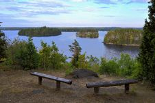 Free Benches Overlooking Body Of Water At Daytime Royalty Free Stock Images - 126178259
