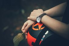 Free Person Holding Black And Orange Helmet Royalty Free Stock Photography - 126178797
