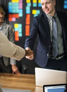 Free Man Wearing Black Suit Jacket Shaking Hands With Person Wearing Beige Jacket Royalty Free Stock Photo - 126178835