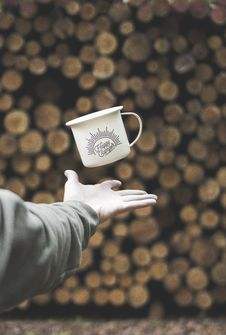 Free Person Flipping White Mug With Happy Camper Print Royalty Free Stock Photo - 126178855