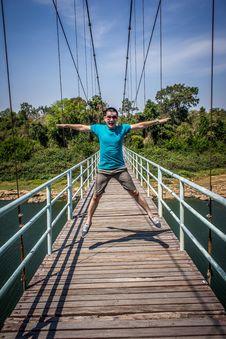 Free Man Jumping On Bridge Stock Photo - 126178920