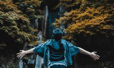 Free Person Spreading His Hands In Front Of Gray Concrete Structure Surrounded By Brown And Green Leaf Trees Stock Photos - 126179003