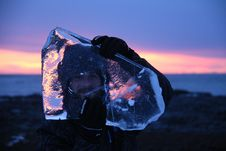Free Person Carrying Block Of Ice While Standing On Hill Royalty Free Stock Image - 126179176
