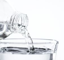 Free Bottle Pouring Water On Glass Stock Photography - 126179232