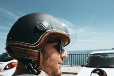 Free Man Wearing Black-and-brown Half-face Helmet And Black Sunglasses Stock Image - 126179241